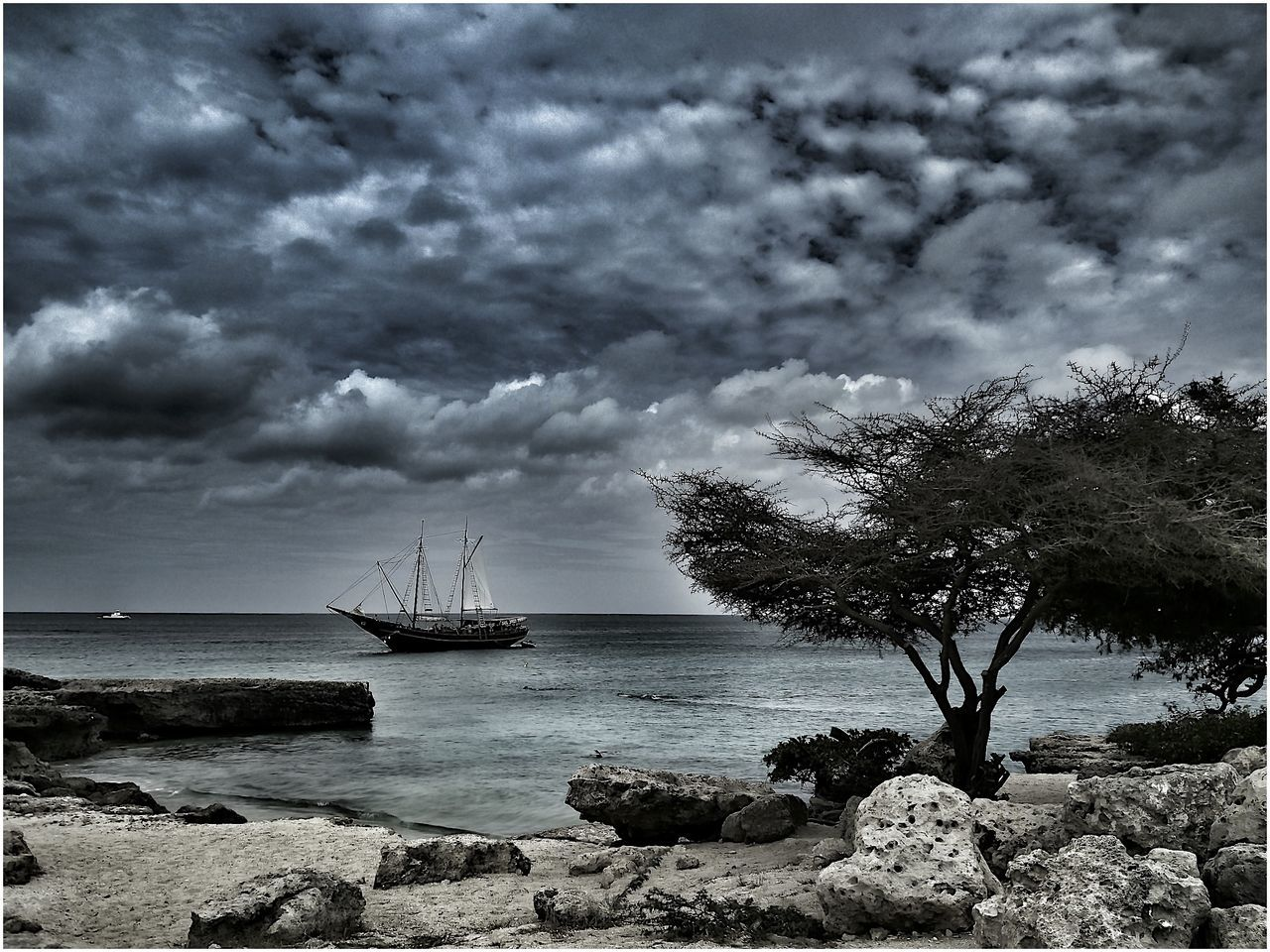 water, sea, sky, cloud - sky, nature, rock - object, horizon over water, beauty in nature, scenics, tranquility, weather, outdoors, no people, tranquil scene, transportation, nautical vessel, day, beach, tree, storm cloud