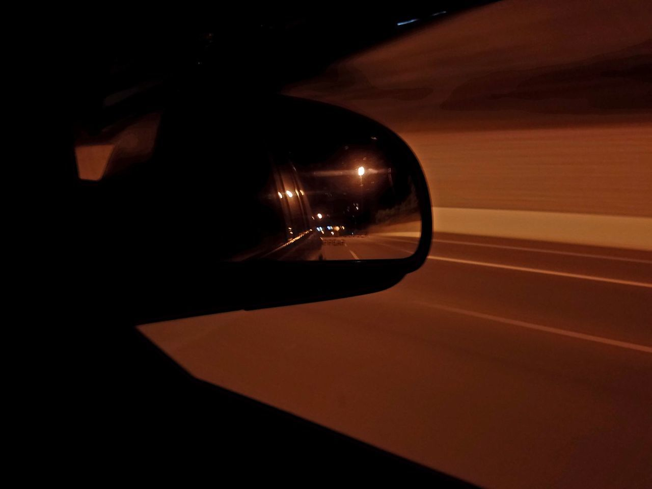 transportation, car, speed, illuminated, mode of transport, side-view mirror, land vehicle, motion, night, reflection, no people, indoors, close-up