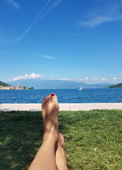 Landscape Barefoot Human Foot Low Section Beach Water Human Leg Summer Horizon Over Water Human Body Part Personal Perspective Sky Relaxation Leisure Activity Outdoors Sea Vacations Woman's Foot Woman's Toes Lake View Lazy Summer Afternoon At The Lake Scenery Own Feet in Lake Garda