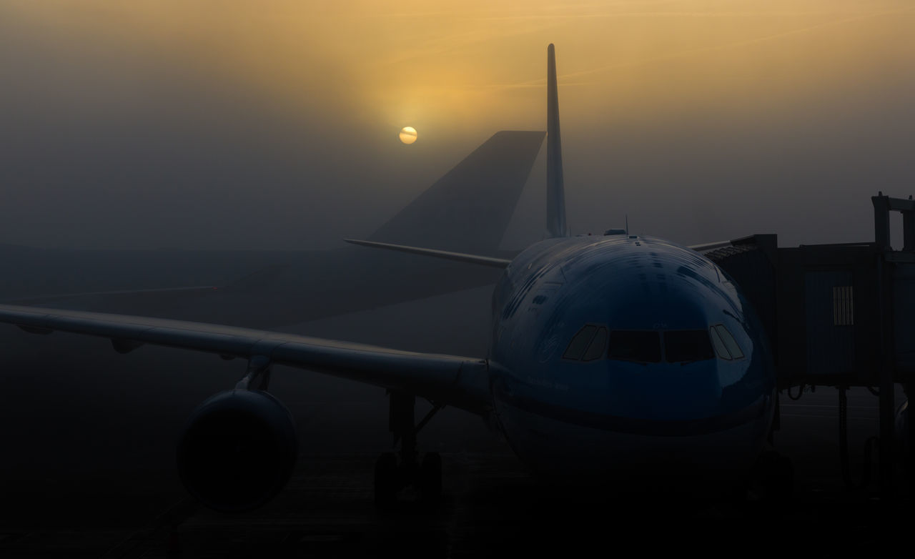 KLM aircraft parked at Schipol Airport. Air Aircraft Airport Airport Runway Beauty In Nature Cloud Cloud - Sky KLM Landscape Mode Of Transport Nature No People Orange Color Outdoors Part Of S Scenics Schipolairport Sky Sun Sunset Tranquil Scene Tranquility