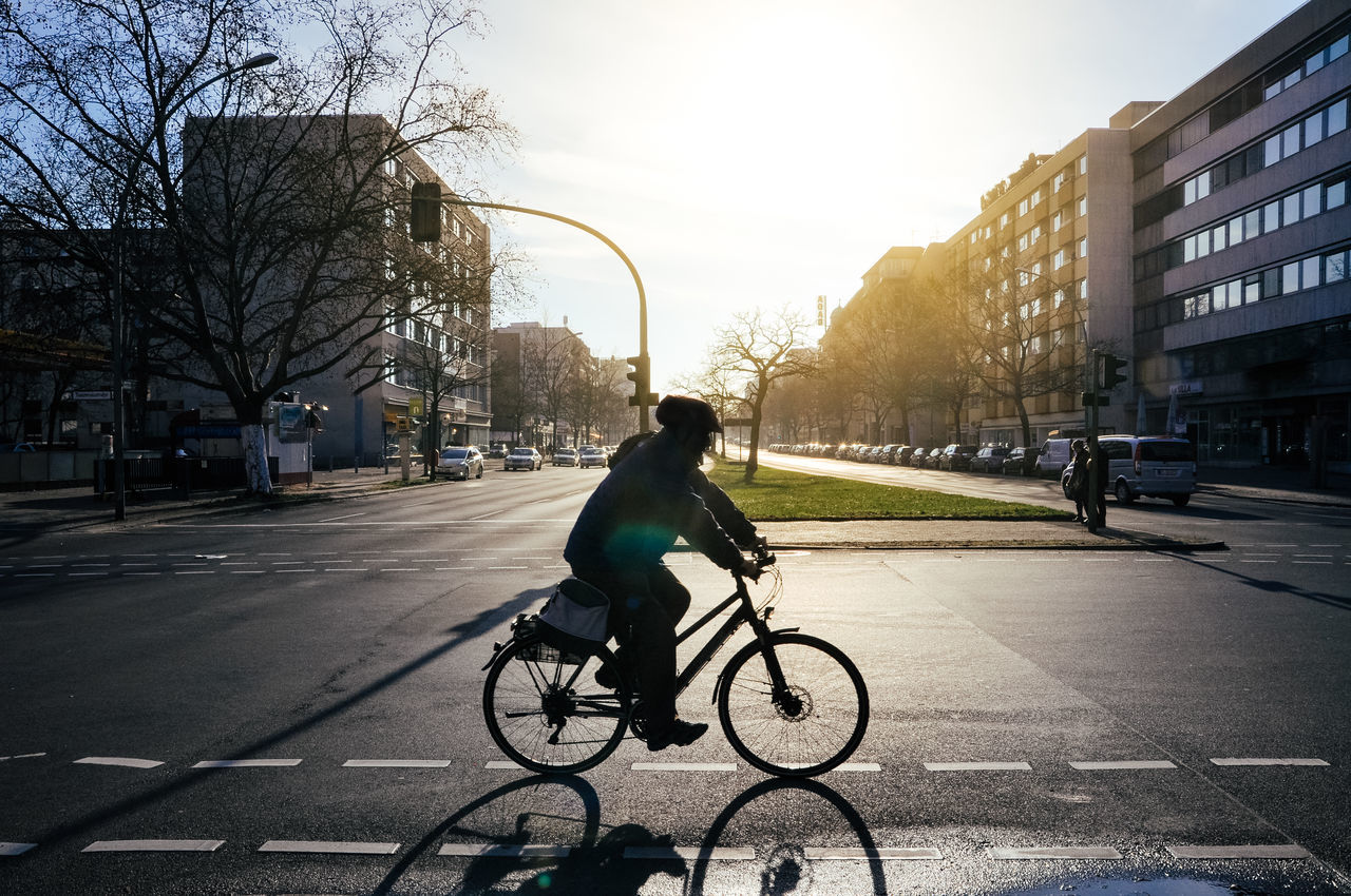Adult Adults Only Berlin Bicycle Business City City Life City Street Commuter Cycling Males  Men Mode Of Transport One Man Only One Person Only Men Outdoors People Riding Road Street Sunset Transportation Urban Road Young Adult