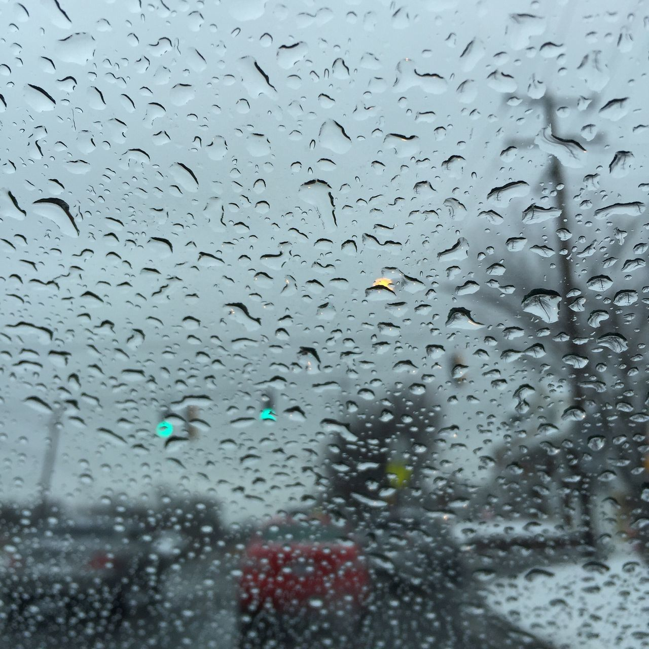 drop, rain, transparent, glass - material, wet, window, vehicle interior, raindrop, weather, rainy season, water, car, car interior, glass, indoors, land vehicle, windshield, no people, day, full frame, looking through window, transportation, close-up, backgrounds, nature, sky