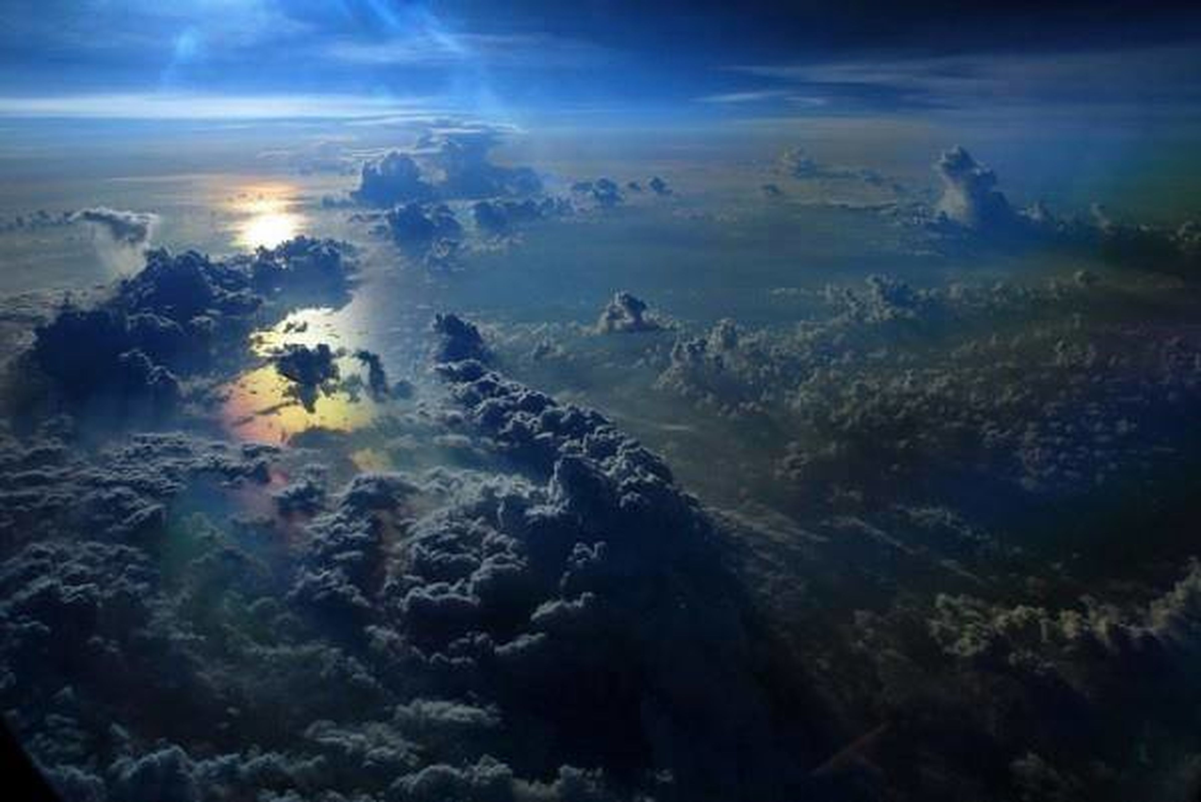 scenics, beauty in nature, sky, tranquil scene, tranquility, cloud - sky, nature, idyllic, aerial view, cloudy, sea, water, cloud, sunset, outdoors, non-urban scene, cloudscape, landscape, majestic, high angle view