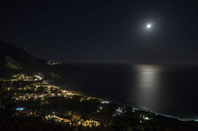 My Lovely Vacation village by night Astronomy City Lights Corfu Day Illuminated Landscape Moon Moon As Star Moon Shots Moonlight Night Night Lights Night Photography Nightphotography