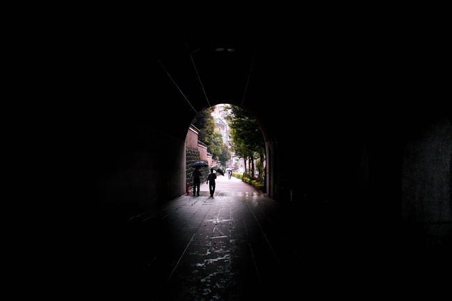 Alley Arch Dark Diminishing Perspective EyeEm Best Shots Footpath Illuminated Indoors  Lifestyles Light Men Pedestrian Walkway Person Road Shadow Shadows & Lights Streetphotography The Way Forward Tunnel Tunnel Vision Walking