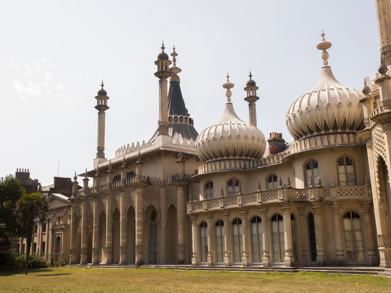 Royal Pavilion Brighton Sussex England The Royal Pavilion, also known as the Brighton Pavilion, is a former royal residence located in Brighton, England. Beginning in 1787, it was built in three stages as a seaside retreat for George, Prince of Wales, who became the Prince Regent in 1811. It is built in the Indo-Saracenic style prevalent in India for most of the 19th century. The current appearance of the Pavilion, with its domes and minarets, is the work of architect John Nash, who extended the building starting in 1815 Architecture Brighton Building Exterior Built Structure Day Dome Façade Famous Place History Hospital Indian Army International Landmark John Nash Lawn Memories Minarets Outdoors Place Of Worship Prince Of Wales Royal Pavilion Royal Residence Spire  Tourism Travel Destinations World War One