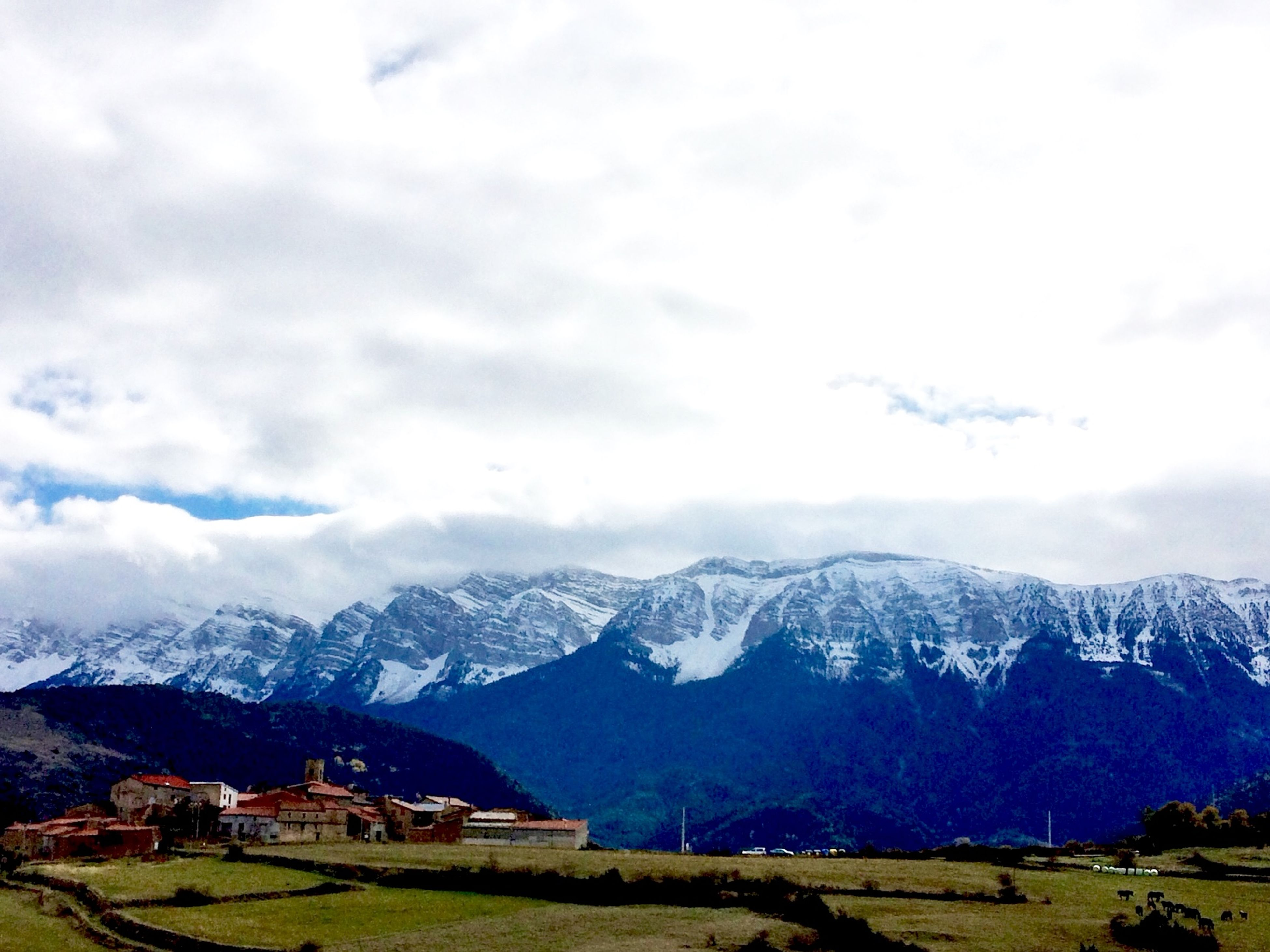 mountain, mountain range, snow, winter, sky, snowcapped mountain, scenics, landscape, tranquil scene, beauty in nature, cold temperature, cloud - sky, tranquility, weather, nature, season, building exterior, house, cloud, cloudy