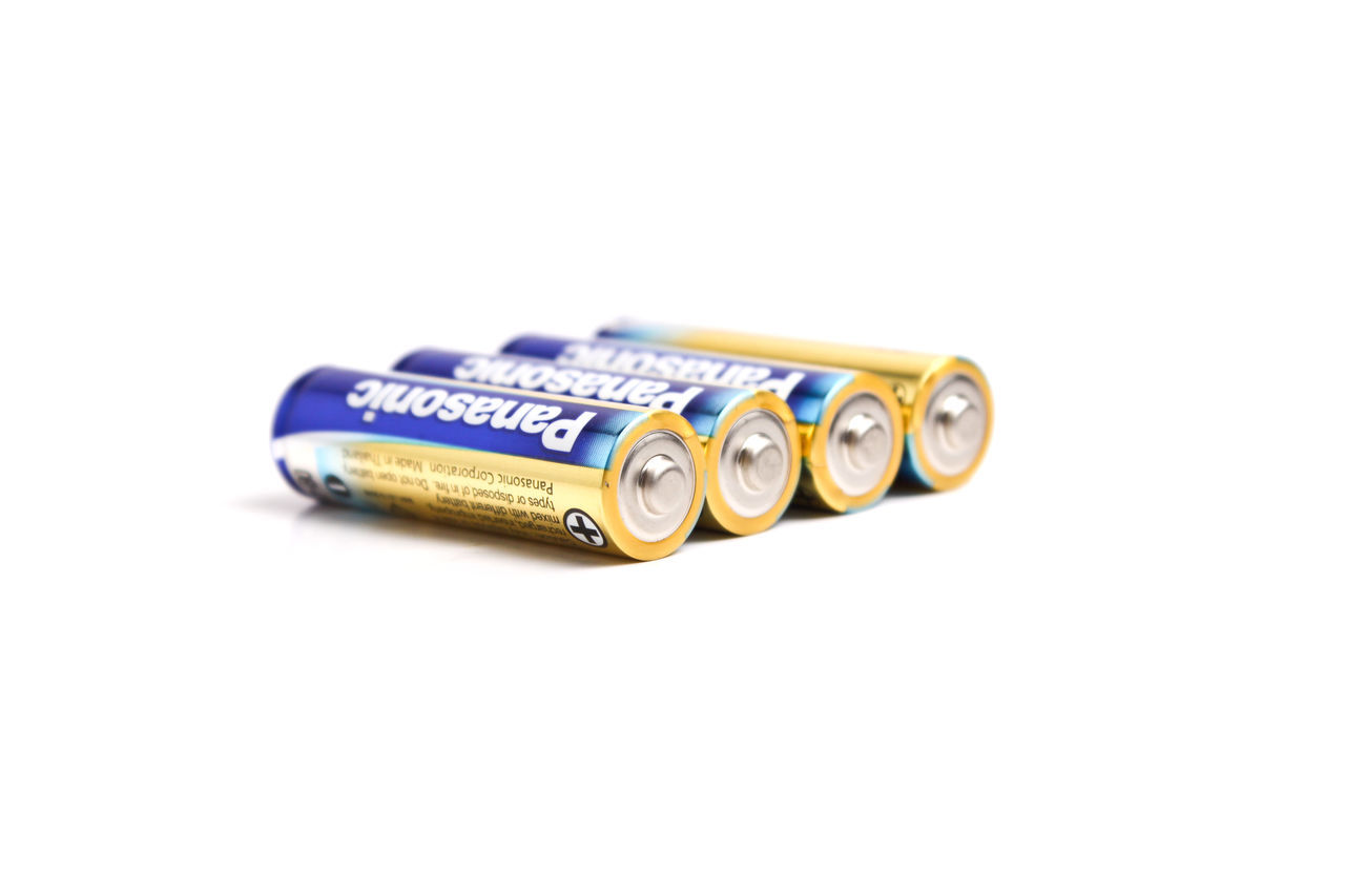 battery isolated on white background Blue Close-up Copy Space Equipment Ideas Man Made Object Multi Colored No People Order Selective Focus Single Object Still Life Studio Shot Western Script White Background