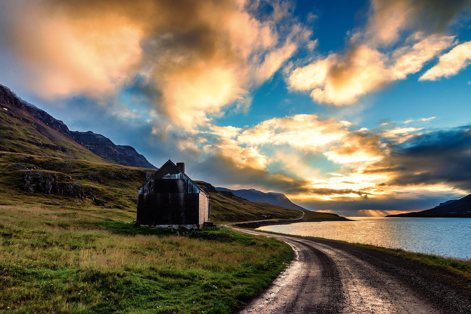 Rusted farm in Seydisfjordur at sunrise, September 2016, Iceland Abandoned Coastline Destination Europe Farm Fjord Gate Iceland Icelandic Isolated Journey Mountain Old Rural Scenic Scenics Seyðisfjörður Simplicity Tourism Tourist Tranquility Travel Unoccupied  Vacations Visit