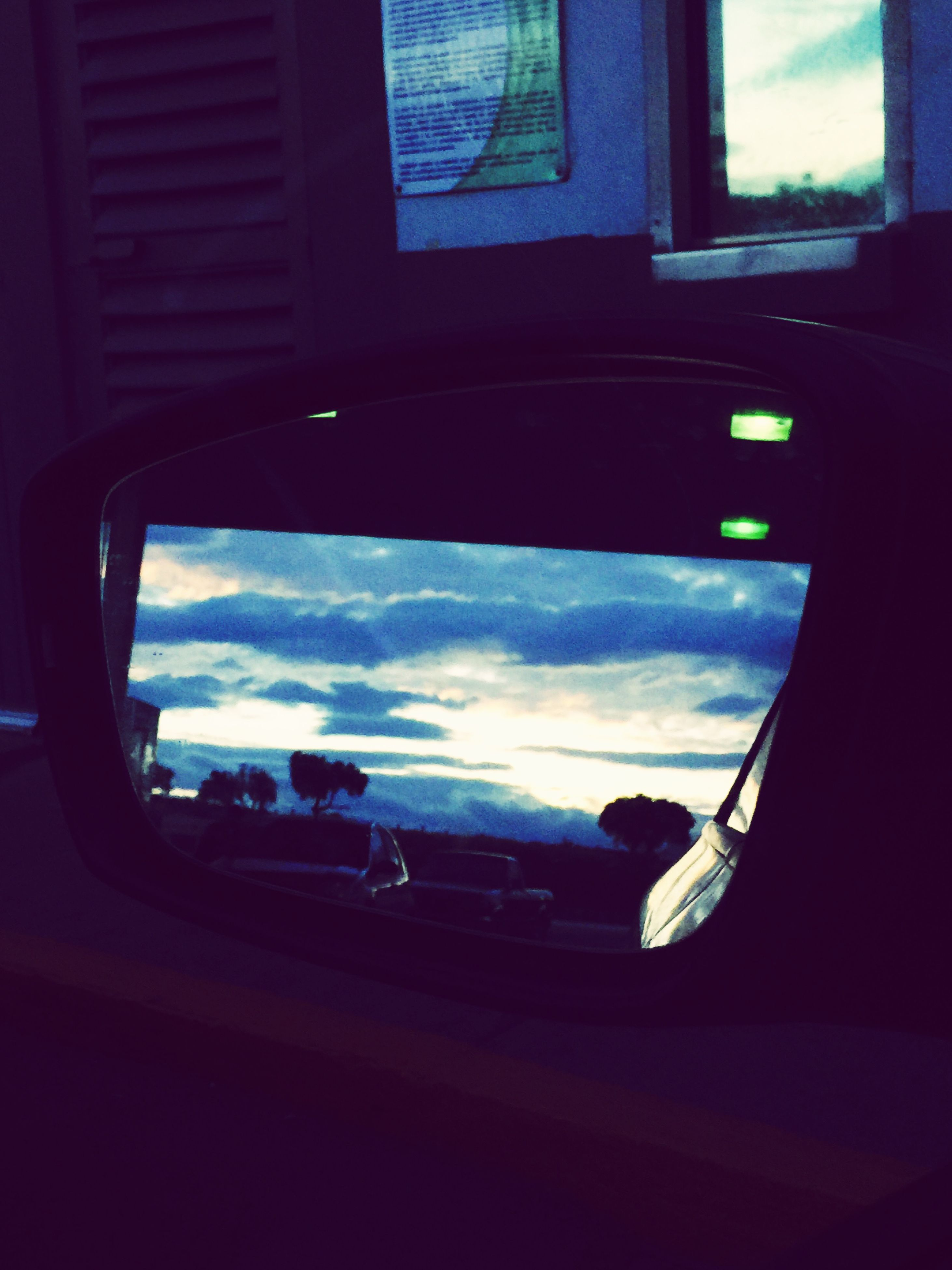 window, transportation, mode of transport, glass - material, transparent, vehicle interior, car, land vehicle, indoors, sky, looking through window, reflection, car interior, side-view mirror, travel, windshield, cloud - sky, glass, cloud, close-up