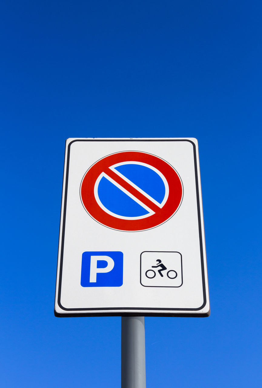 blue, guidance, symbol, clear sky, road sign, low angle view, communication, day, no people, outdoors
