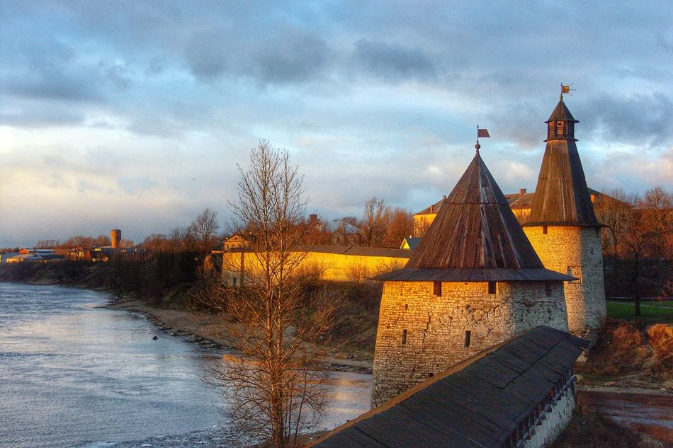 Architecture Sky Built Structure Building Exterior Cloud - Sky Dusk Dramatic Sky Travel City Travel Destinations Sunset No People Outdoors Cultures Tree Cityscape Clock Tower Nature Day Pskov Castle Walls Castle Tower Towers Fortress River