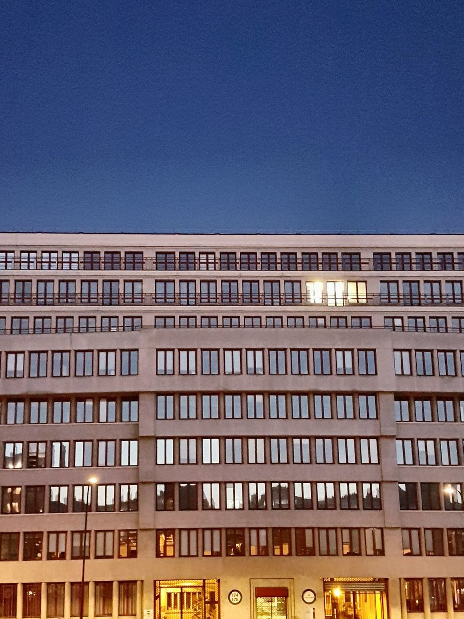 Façade Architecture Business Finance And Industry Office Building Exterior City Night Illuminated Built Structure Low Angle View Building Exterior Outdoors Cityscape No People Sky Politics And Government