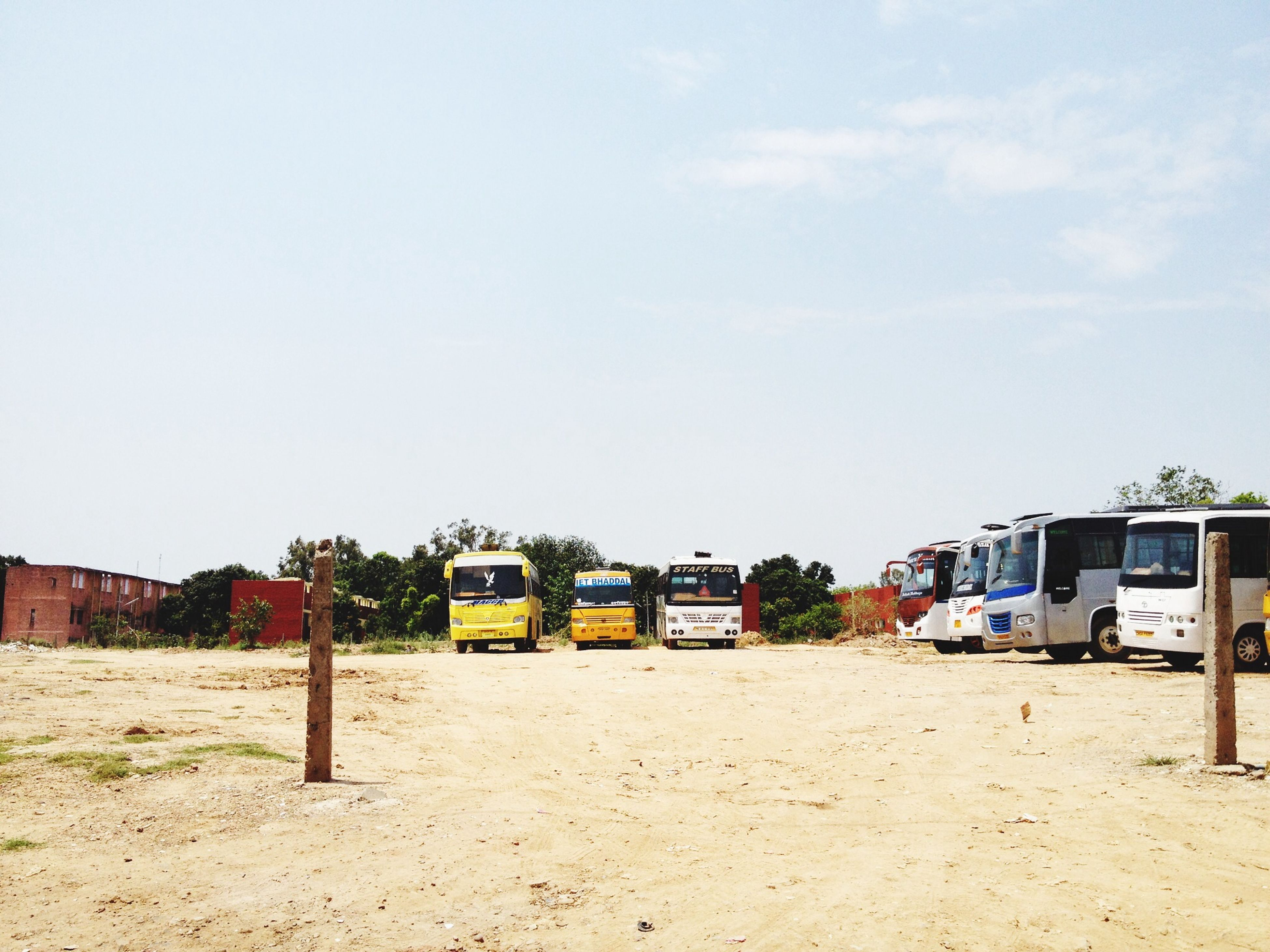 sand, transportation, sky, beach, mode of transport, clear sky, built structure, land vehicle, car, day, building exterior, architecture, outdoors, copy space, absence, no people, empty, tree, sunlight, abandoned