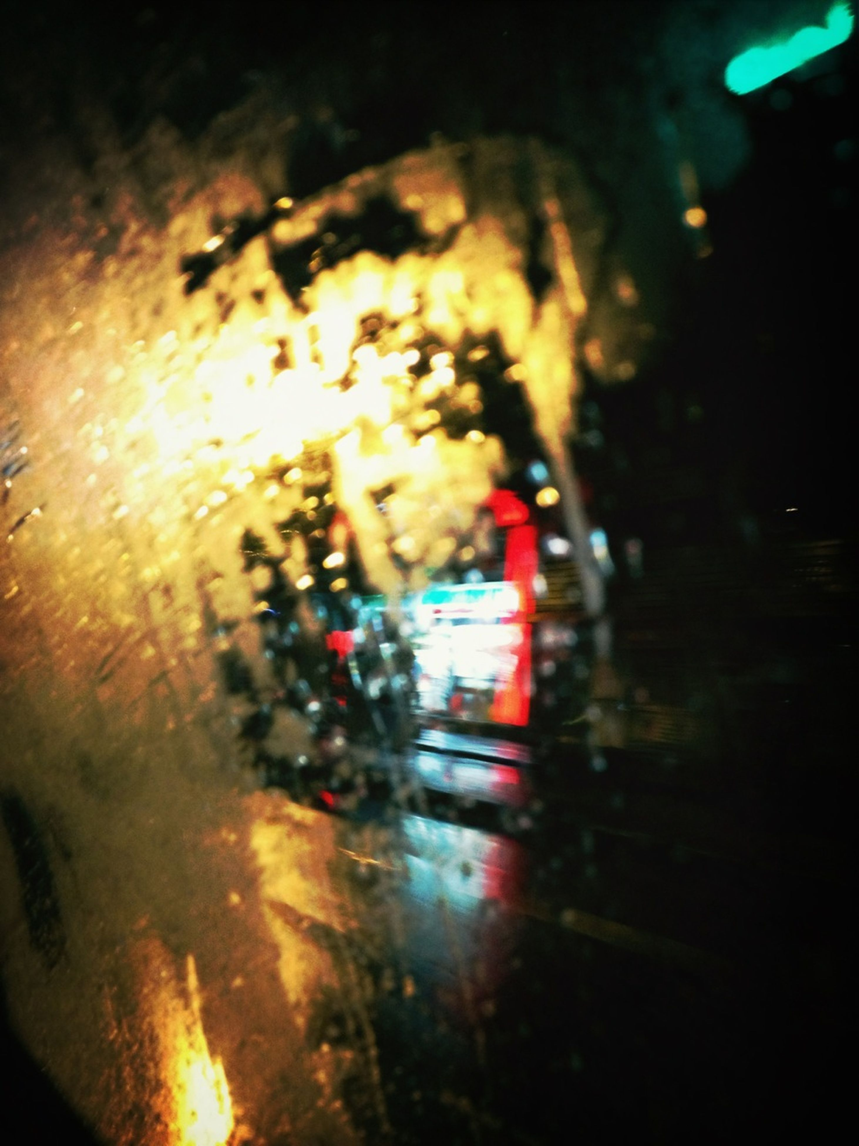 night, illuminated, transportation, land vehicle, indoors, mode of transport, car, wet, street, glass - material, rain, motion, close-up, blurred motion, window, light - natural phenomenon, road, transparent, glowing, reflection