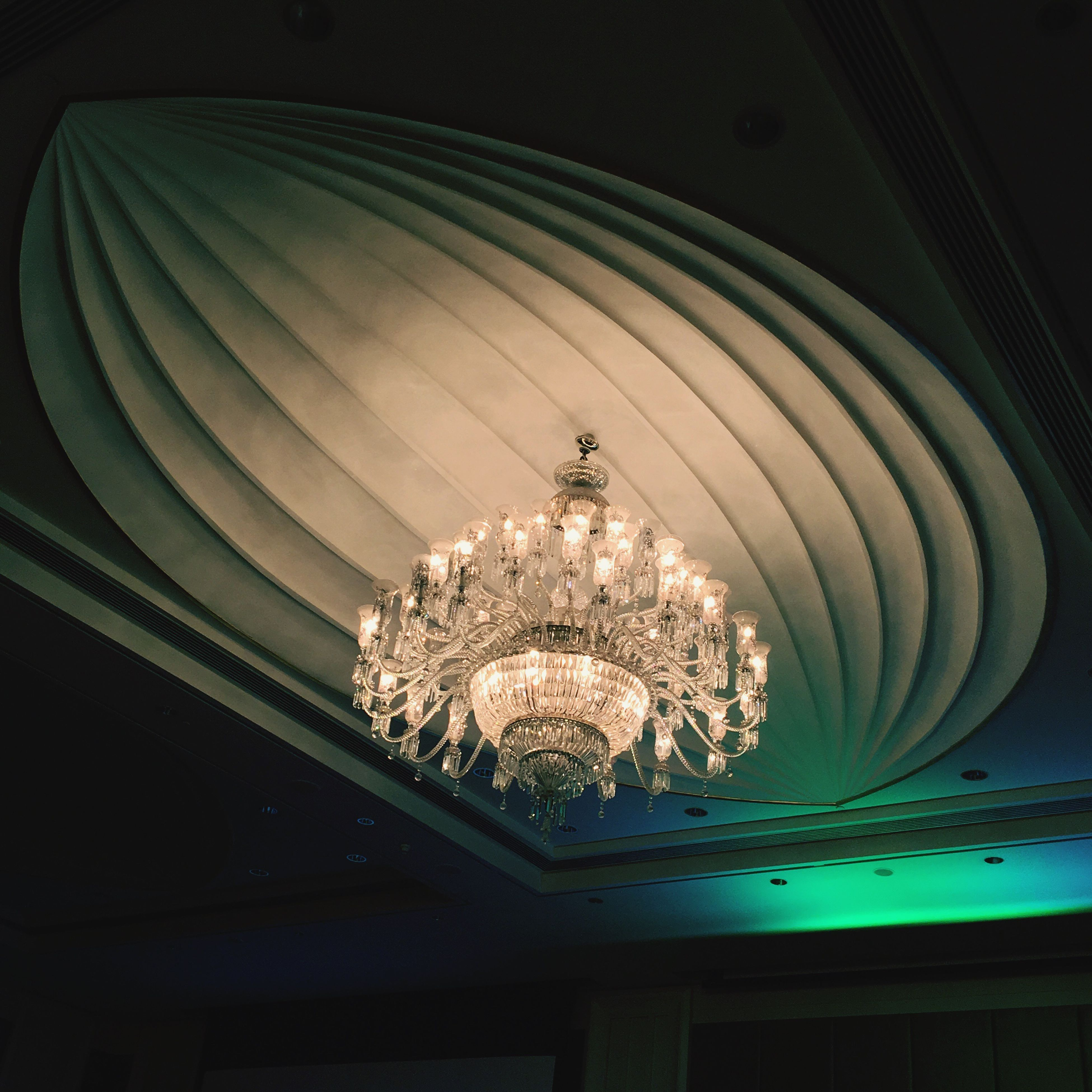 hanging, ceiling, low angle view, lighting equipment, illuminated, indoors, luxury, chandelier, elegance, glowing, close-up, electric light, decor, decoration, hanging light, green color, lit, modern, geometric shape, day, bright, multi colored