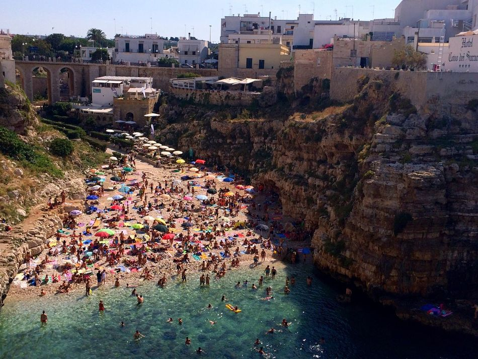 People And Places High Angle View Water Vacations Crowded Elevated View Italian Landscapes Polignano A Mare Summertime Summer 2016 Experiencing Places Beach People Umbrellas