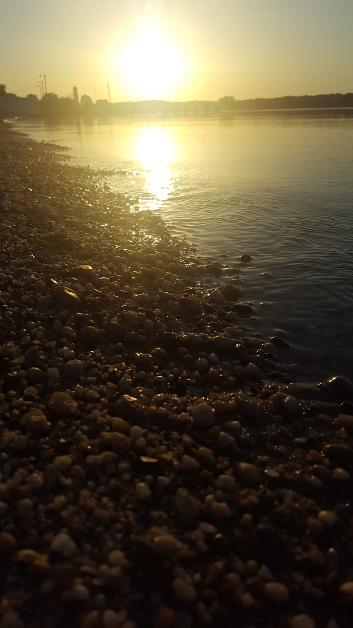 sunset, nature, water, beauty in nature, tranquility, sun, tranquil scene, scenics, sea, beach, outdoors, no people, sky, pebble, pebble beach, day