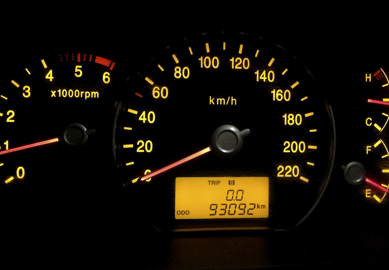Backlit gauges of a car. Yellow glowing meters with a red needle Close-up Dashboard Gauge Meter - Instrument Of Measurement Motorsport No People Number Speed Speedometer Sport Technology