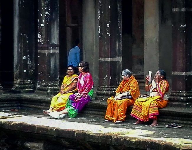 Overnight Success Full Length Religion Spirituality Traditional Clothing Sitting Place Of Worship Dark People Outdoors Person Only Women Night Horizontal Headwear Adult Architecture Young Adult Travel Destinations TakeoverContrast Multi Colored EyeEm Gallery Eyemmarket People And Places Streetphotography