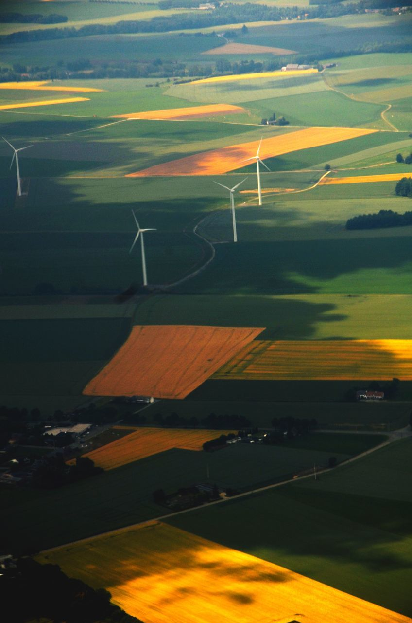 High Angle View Of Wind Turbines On Patchwork Landscape