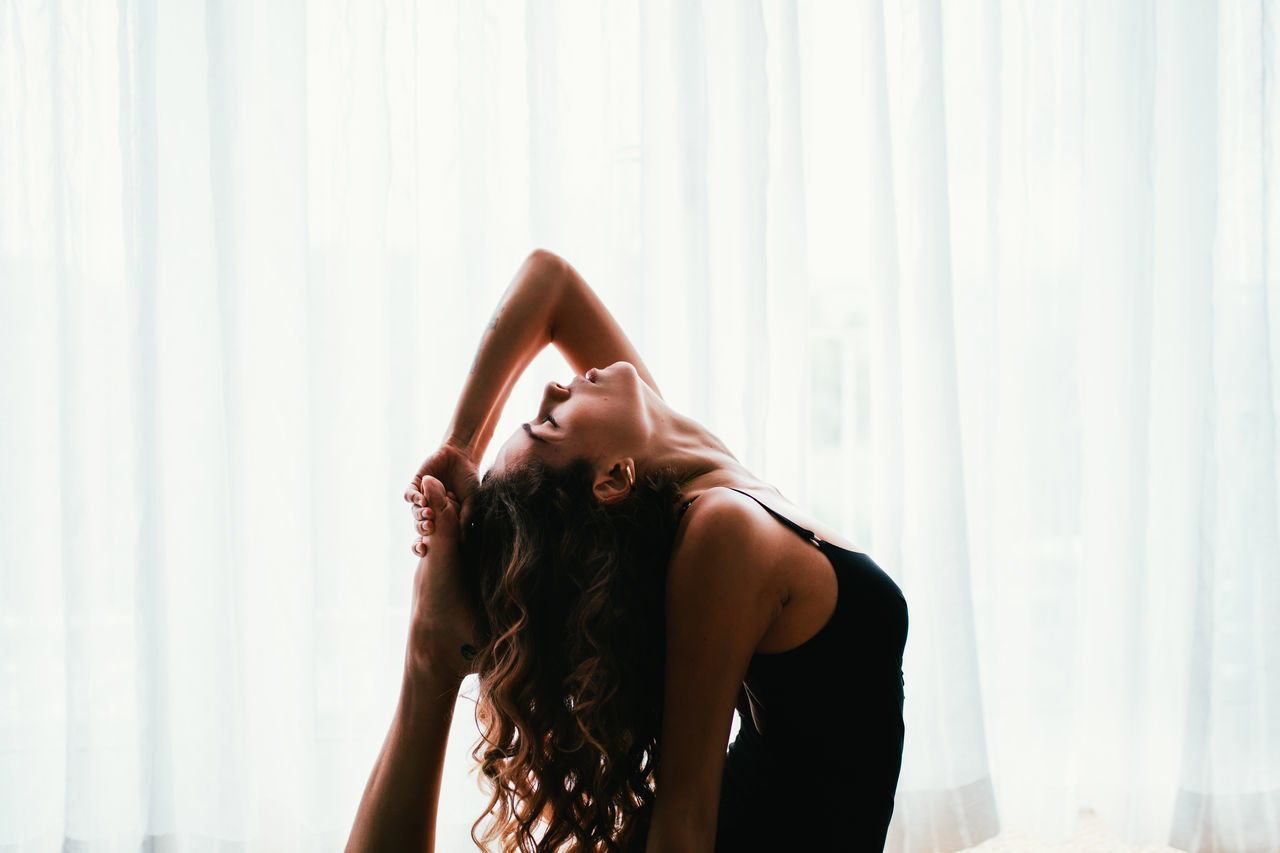 Home Woman Yoga Yoga Pose curtains day fit fitness Hand in hair indoors leisure activity lifestyles sport yoga practice yogaeverydamnday yogagirl yogi The Week on EyeEm Fresh on Market 2017