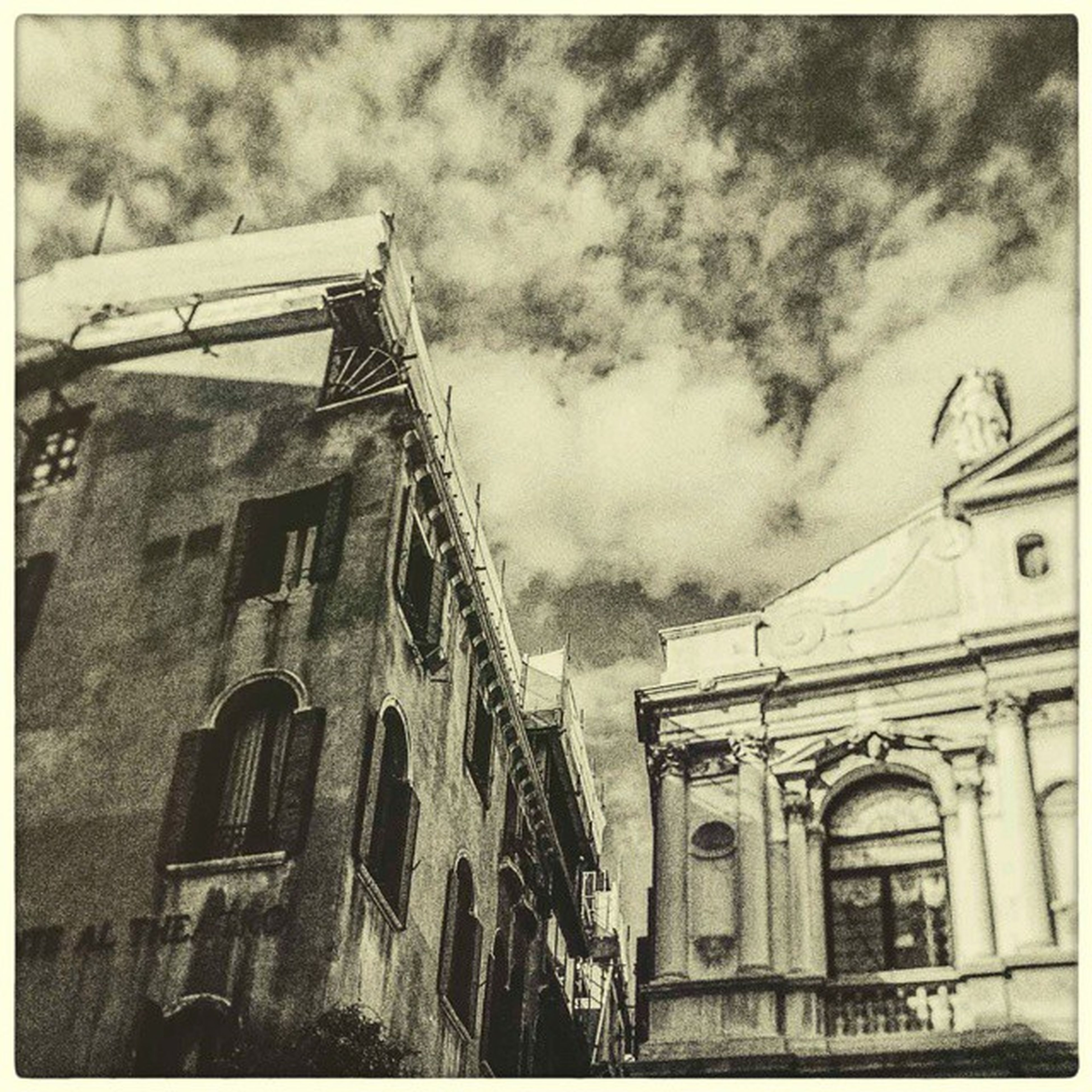 architecture, building exterior, built structure, low angle view, sky, transfer print, cloud - sky, auto post production filter, cloudy, building, window, cloud, residential structure, residential building, church, old, outdoors, day, house, no people