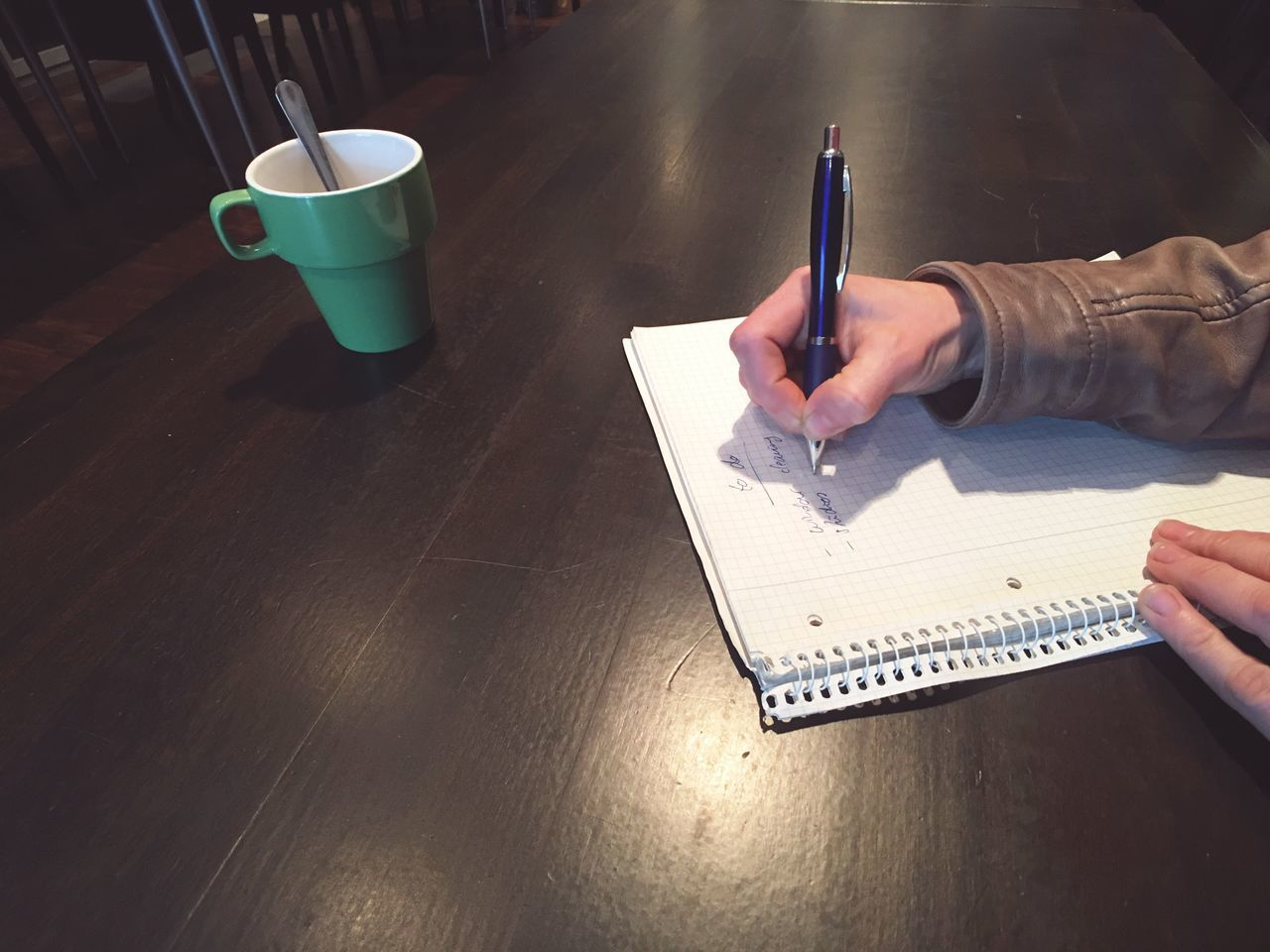 Writing a list Table Coffee Cup Human Hand Pen Real People One Person Indoors  Human Body Part Adult Writing Paper List Block Notebook