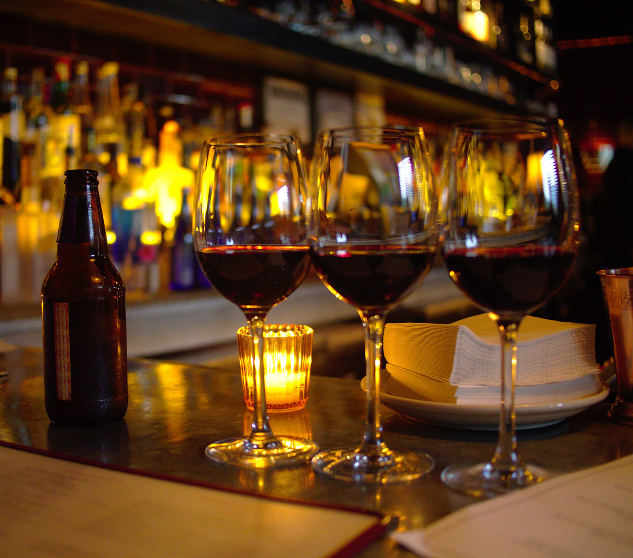 wineglass, alcohol, wine, red wine, bottle, refreshment, drink, alcoholic drink, food and drink, table, indoors, wine bottle, drinking glass, focus on foreground, freshness, close-up, no people, illuminated, barrel