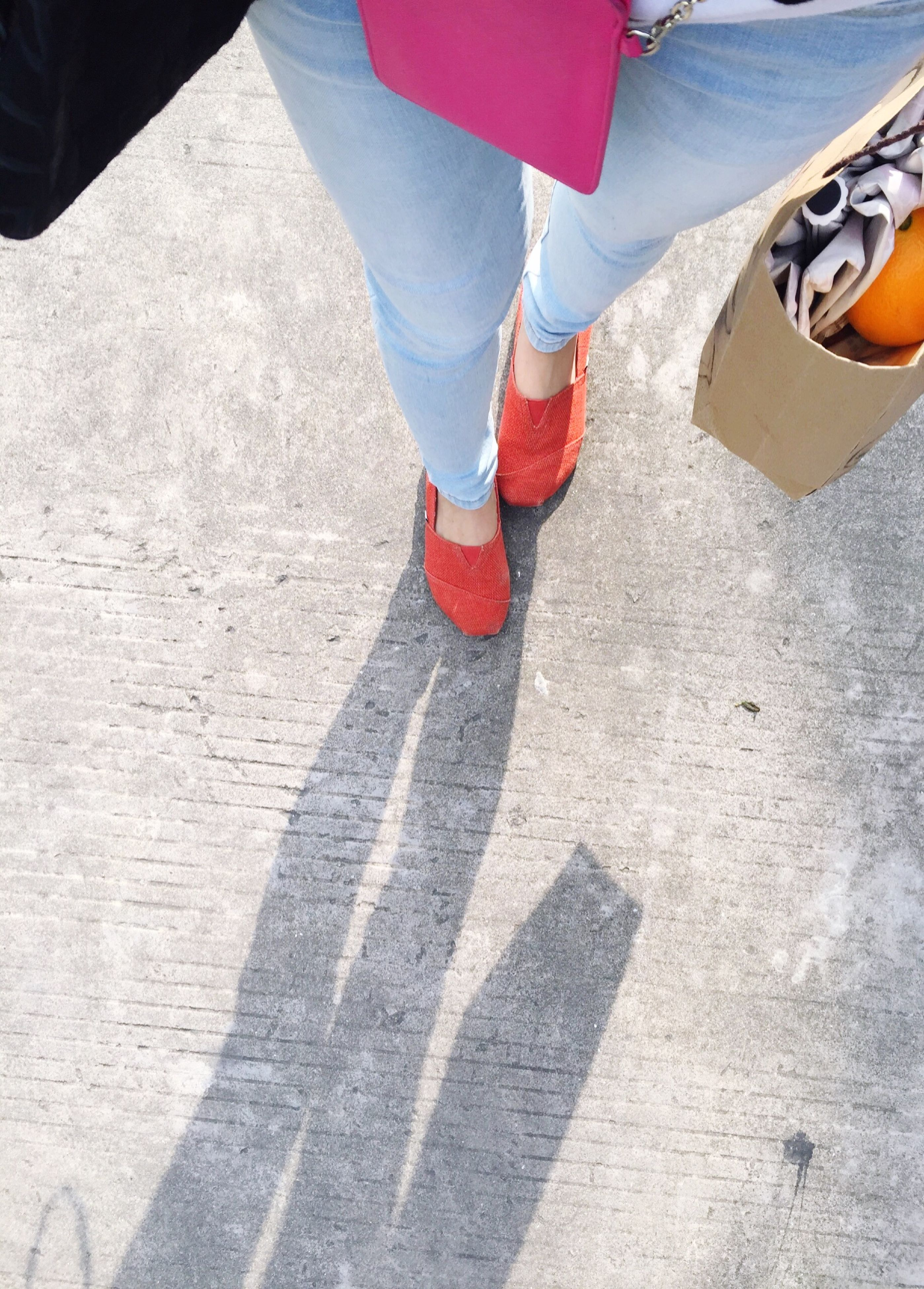 low section, person, lifestyles, street, men, shoe, high angle view, leisure activity, standing, walking, human foot, footwear, unrecognizable person, road, part of
