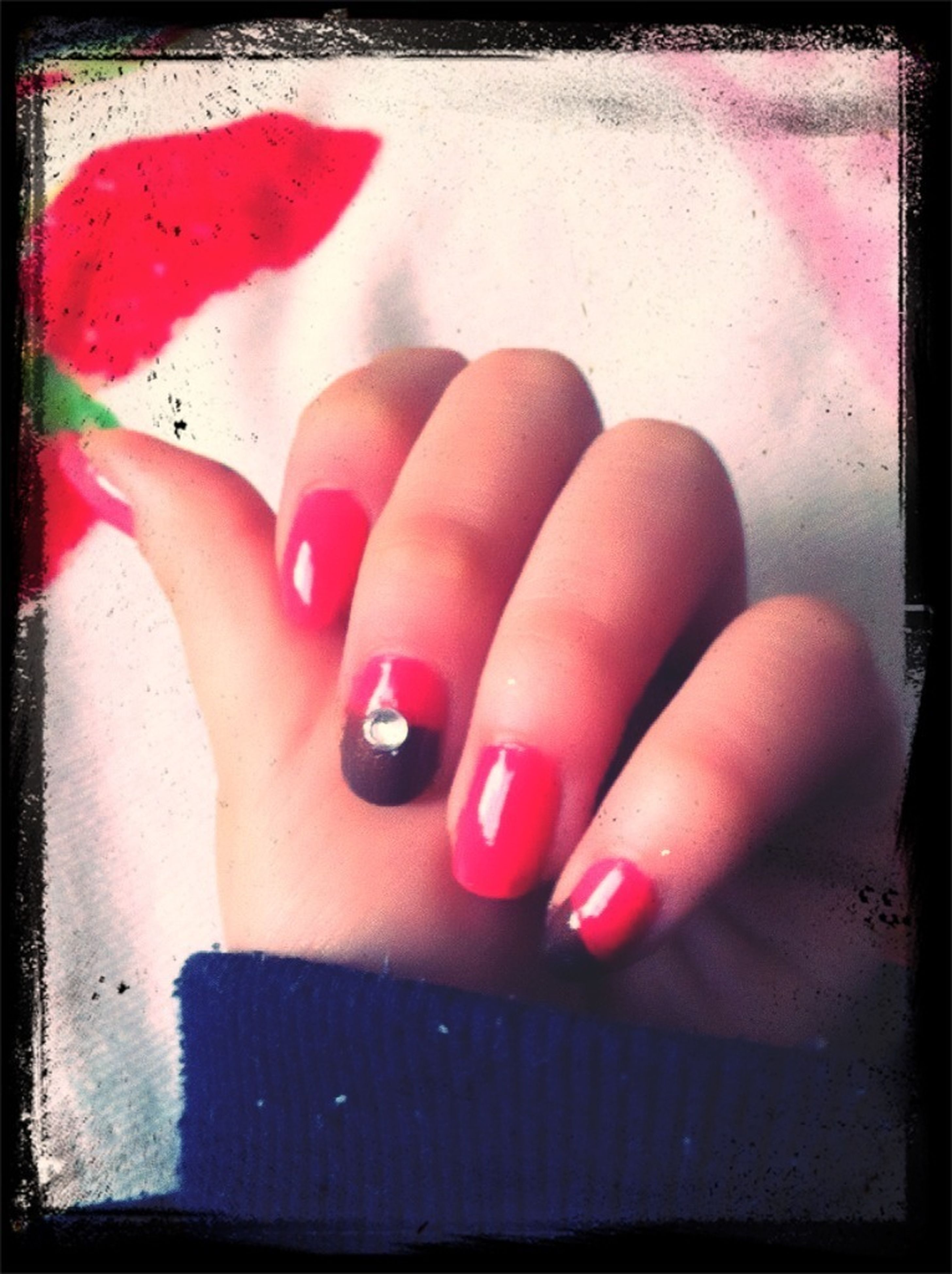indoors, transfer print, person, red, auto post production filter, part of, lifestyles, close-up, high angle view, holding, human finger, pink color, cropped, leisure activity, nail polish, personal perspective