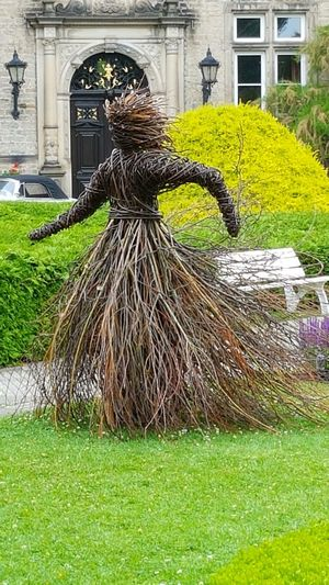 Statue Made Of Willow Rod Grass Architecture Outdoors Green Color Built Structure Day No People Building Exterior Garden Photography Outdoor Photography Dancing Figure Beauty In Nature Outdoor Photography Graden Photography She Is Called The Dancer