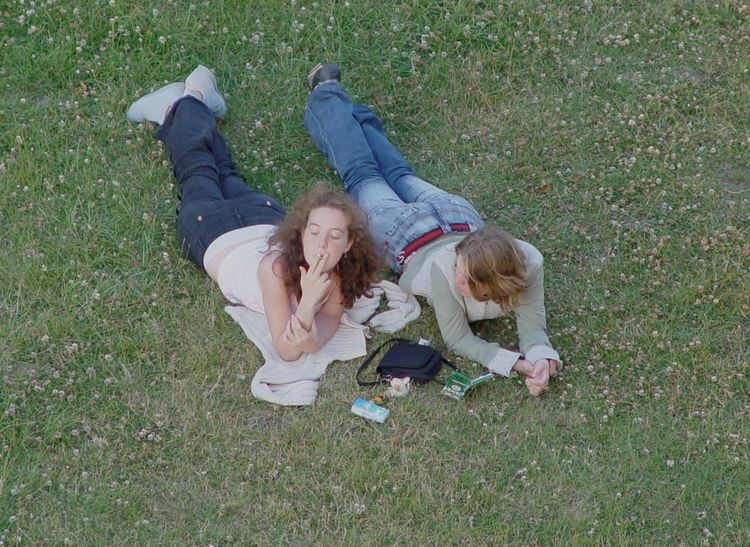 Friends 2007 Beauty Of Nature Bretagne Casual Clothing Females France Friendship Full Length Girls Grass Happiness High Angle View Leisure Activity Lying Down Mont Dol Outdoors Relaxation Smiling Smoking Togetherness
