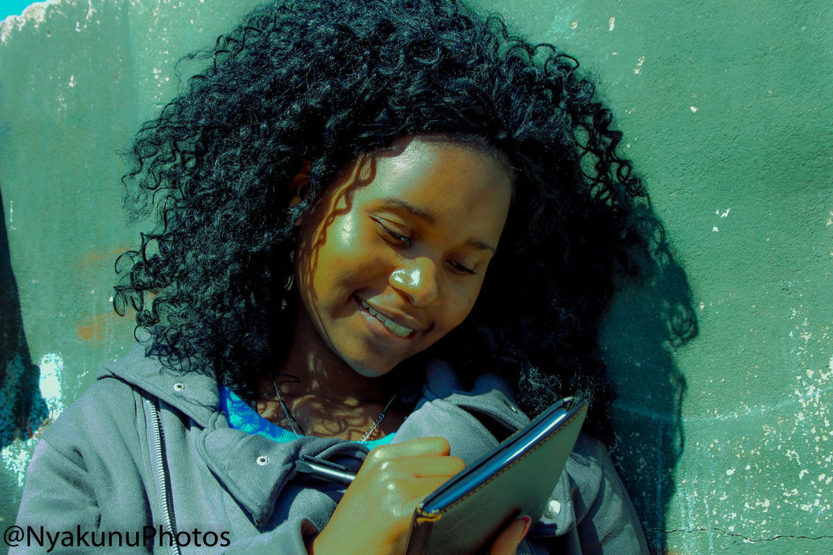 An artist can write poetry at any point, however, be as good enough a model to pose and get a picture. Beautiful Girl Complexion Hairstyle In The Sun Photography Pose Smiles Writing First Eyeem Photo