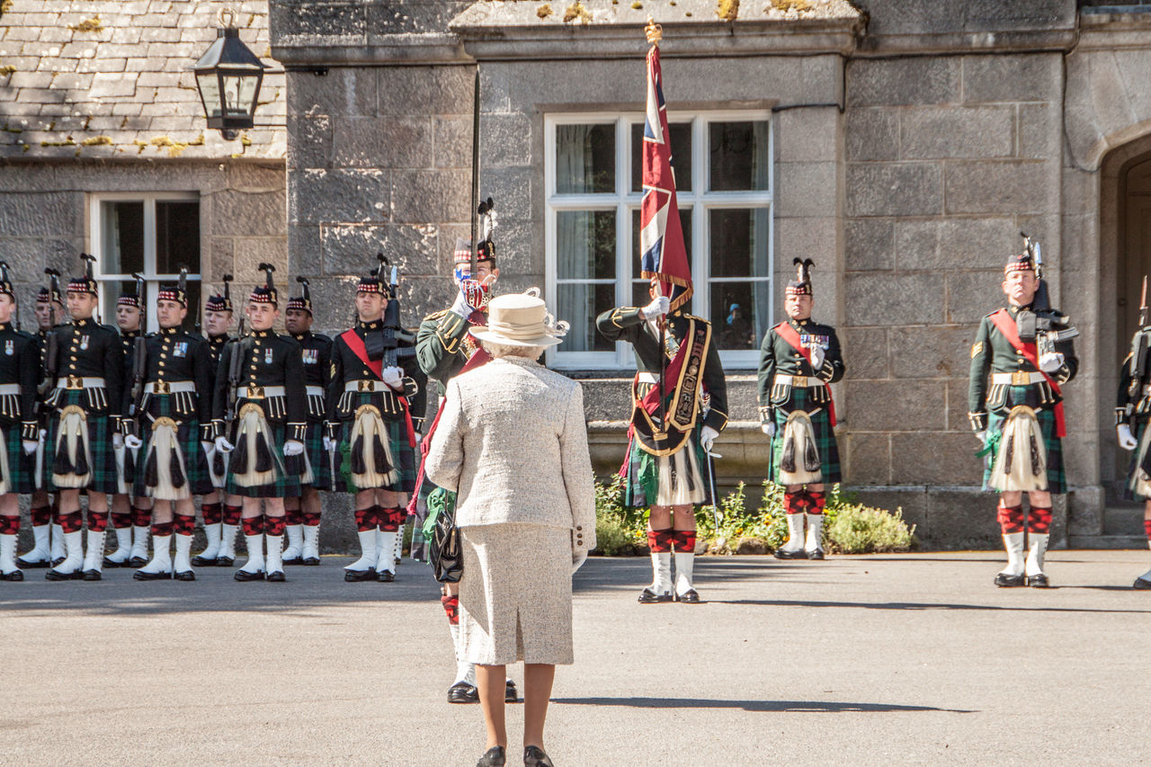 The Queen inspects the Royal Guard outside the gates to Balmoral Castle Balmoral Castle Flag Guards Queen Elizabeth  The Queen The Royal Guard The Royal Regiment Of Scotland