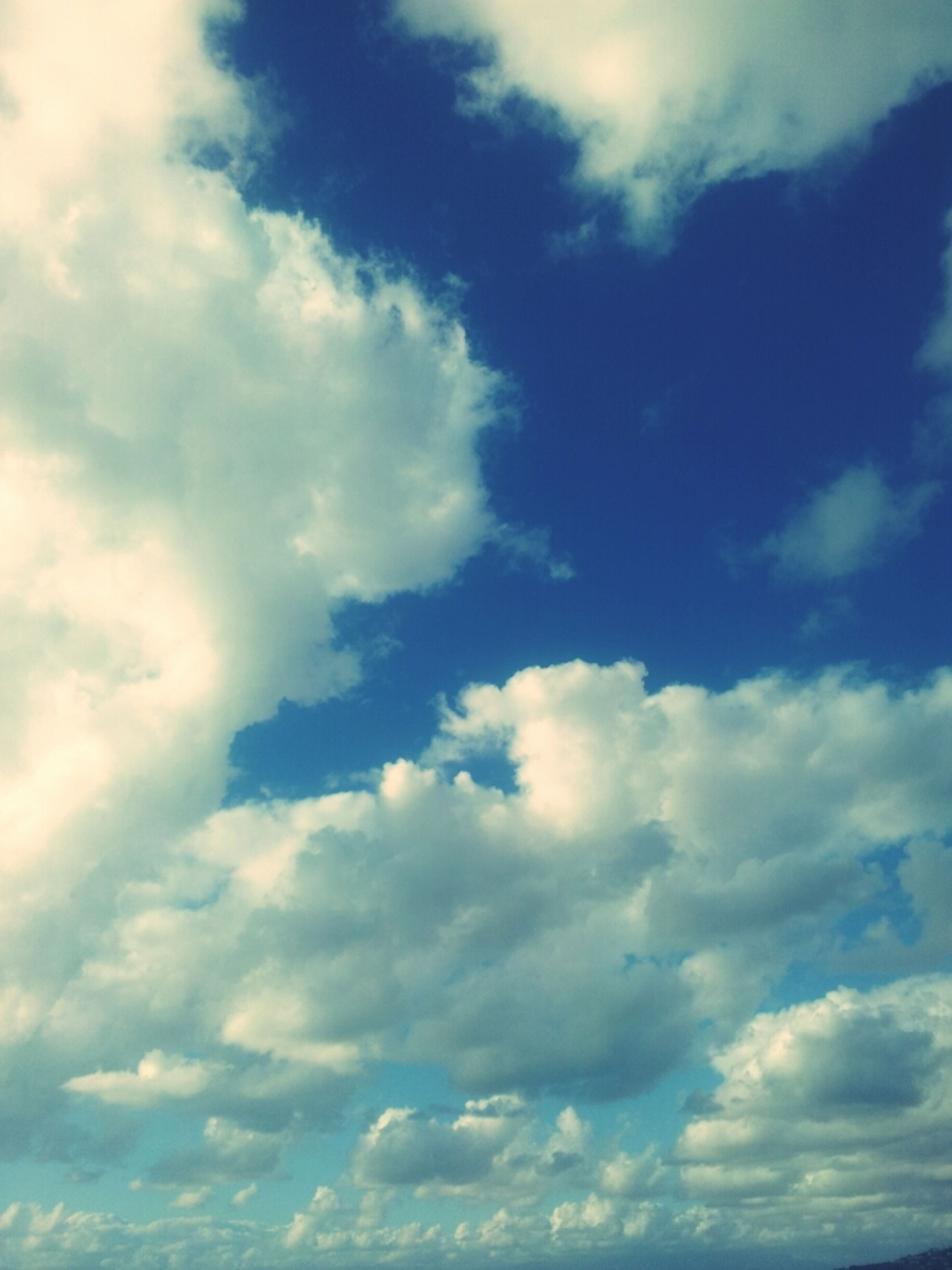 sky, cloud - sky, low angle view, tranquility, beauty in nature, scenics, sky only, tranquil scene, cloudy, nature, cloudscape, cloud, blue, backgrounds, idyllic, full frame, white color, outdoors, day, no people