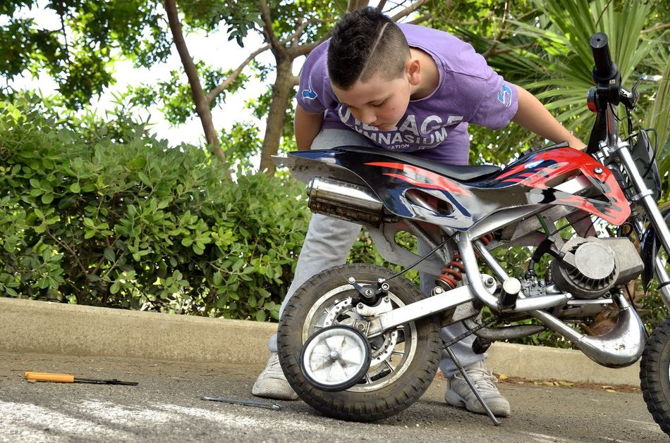 Adult Adults Only Child Childhood Children Children Only Children Photography Children Playing Day Looking Down Mini Bike Mini Moto Mini Motocross Mini Motorbike Mini Motorcycle Minibike One Person One Woman Only One Young Woman Only Only Women Outdoors Paralysis People Standing Transportation