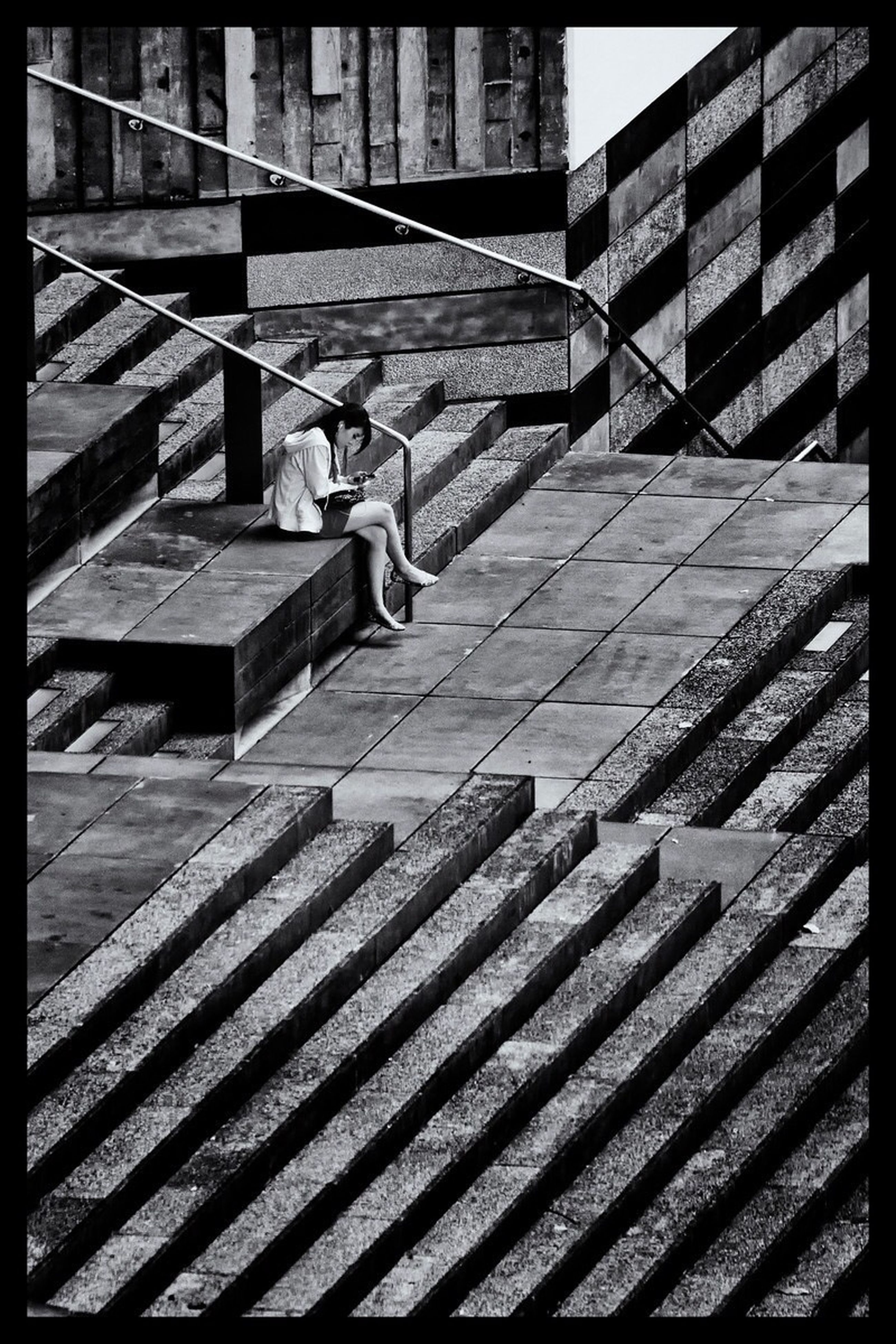 transfer print, architecture, built structure, building exterior, auto post production filter, low angle view, building, pattern, sunlight, day, outdoors, brick wall, no people, city, steps, shadow, wall - building feature, in a row, repetition, railing