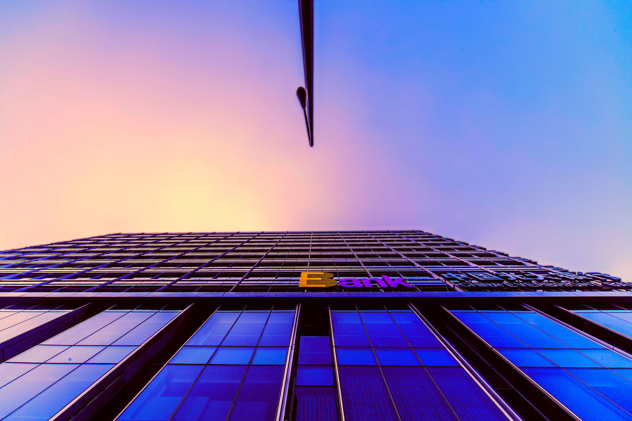 architecture, built structure, low angle view, building exterior, no people, clear sky, sky, outdoors, day, blue, modern, skyscraper, city