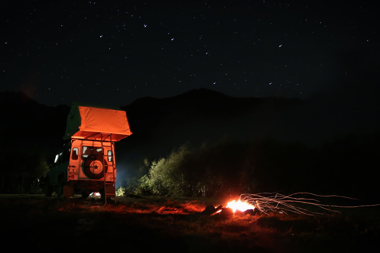 Clear Sky Dark Fire - Natural Phenomenon Illuminated Motion Mountain Nature Night Orange Color Outdoors Sky Tail Light Transportation