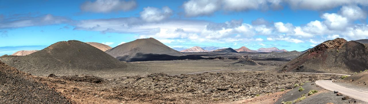 Panoramic View Of Mountains Against Cloudy Sky At Timanfaya National Park