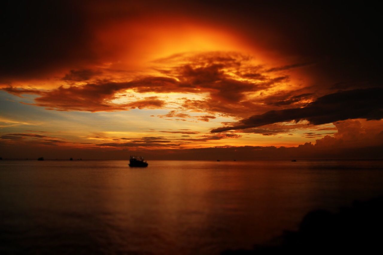 sunset, sea, cloud - sky, beauty in nature, orange color, scenics, nature, water, sky, tranquility, silhouette, tranquil scene, dramatic sky, no people, horizon over water, waterfront, outdoors, nautical vessel