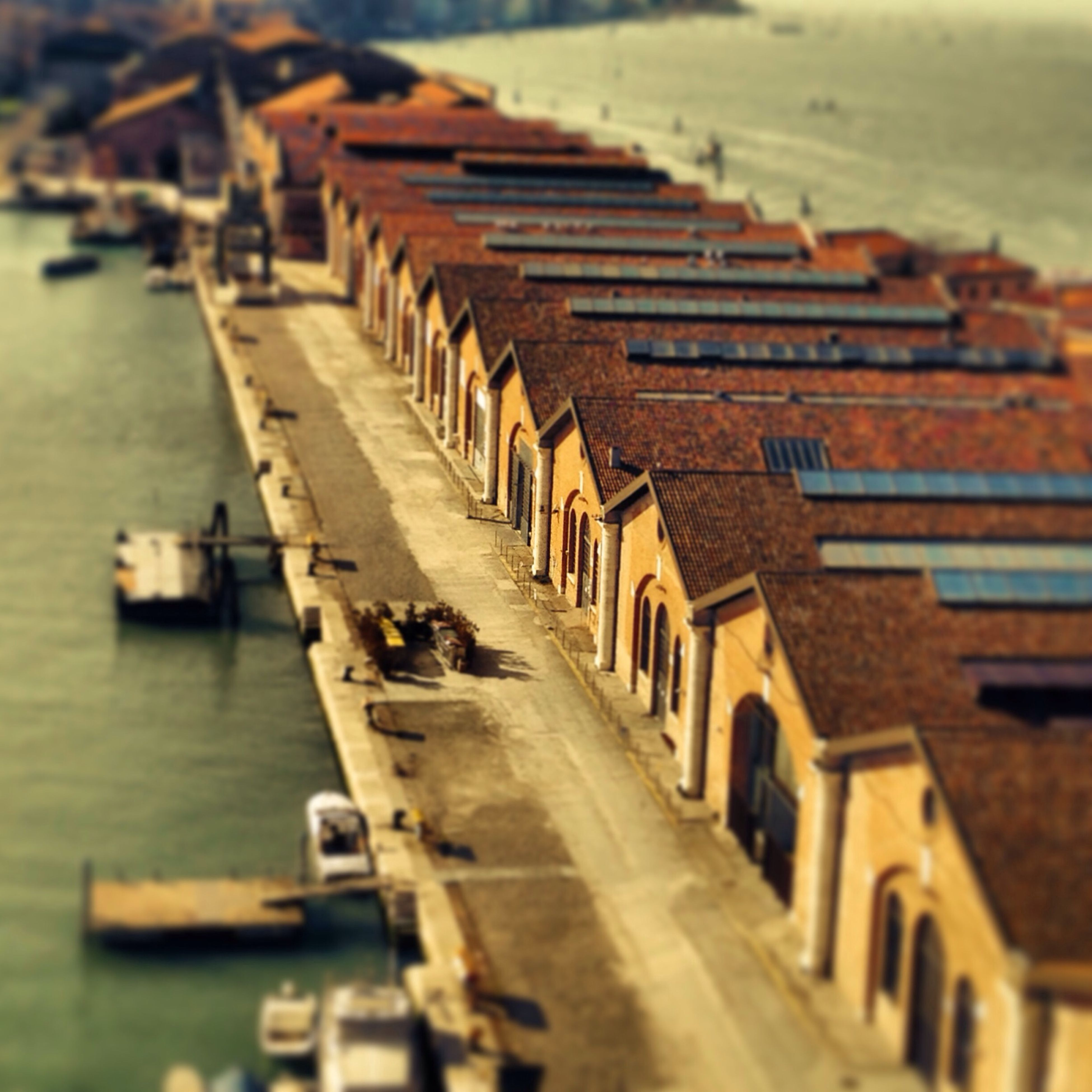 water, in a row, built structure, transportation, selective focus, architecture, building exterior, the way forward, diminishing perspective, focus on foreground, river, pier, railing, day, outdoors, incidental people, wood - material, no people, nautical vessel, street