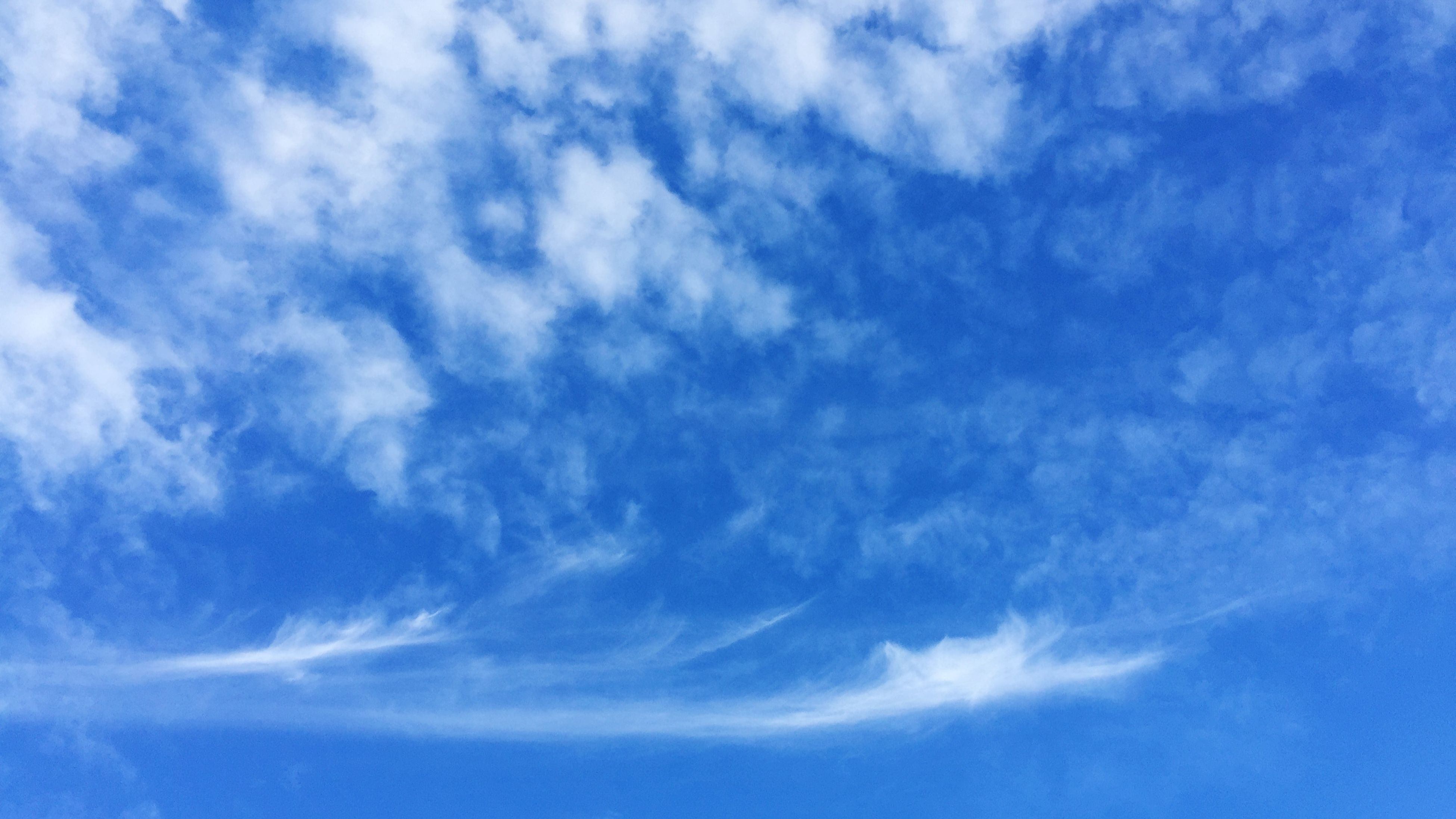 sky, blue, low angle view, cloud - sky, beauty in nature, tranquility, sky only, scenics, nature, tranquil scene, backgrounds, cloudy, cloud, cloudscape, full frame, idyllic, outdoors, day, white color, no people