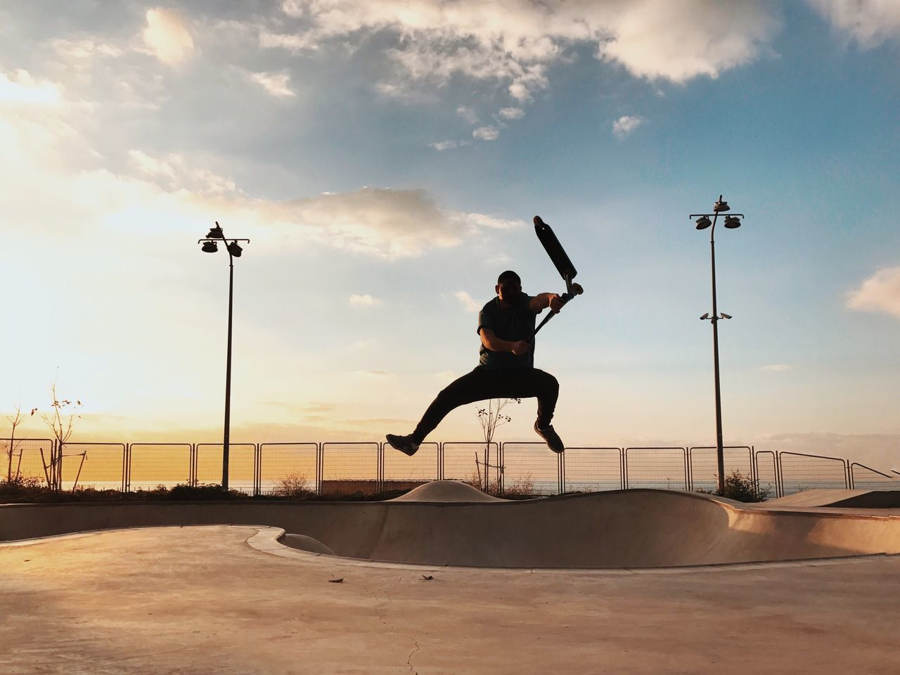 Jumping Leisure Activity Full Length Mid-air Skill  One Person Real People Sky Lifestyles Sunset Cloud - Sky Sport Vitality Outdoors Motion Exercising Day Men Skateboard Park Energetic Shotoniphone7plus מייאייפון7 IPhone7Plus The Street Photographer - 2017 EyeEm Awards מייסקייט