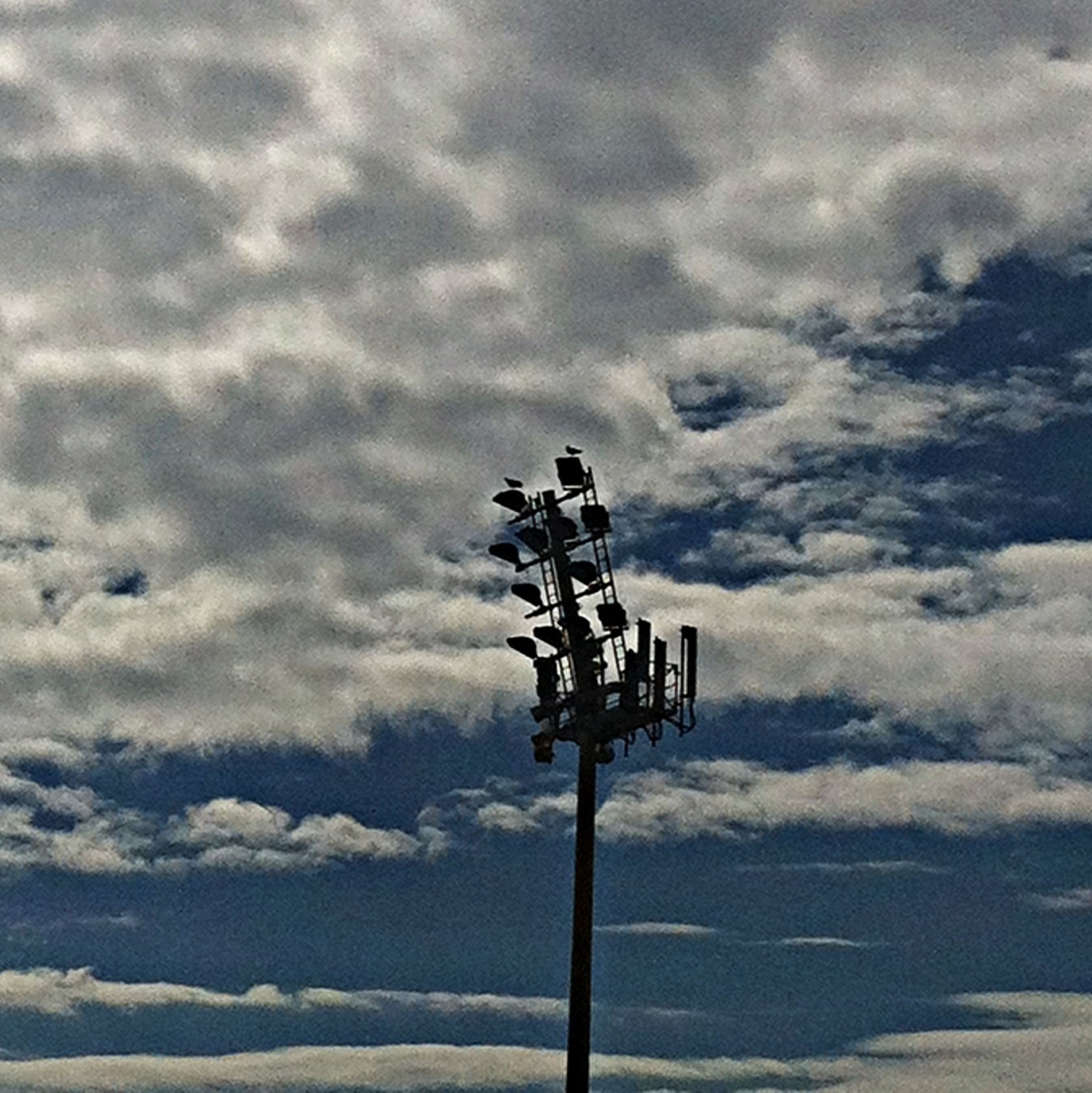sky, cloud - sky, cloudy, low angle view, weather, street light, overcast, cloud, lighting equipment, tranquility, technology, nature, silhouette, outdoors, day, pole, no people, electricity, scenics, tranquil scene