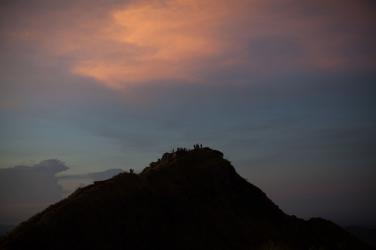 Silhouette Mountain Against Cloudy Sky At Sunset