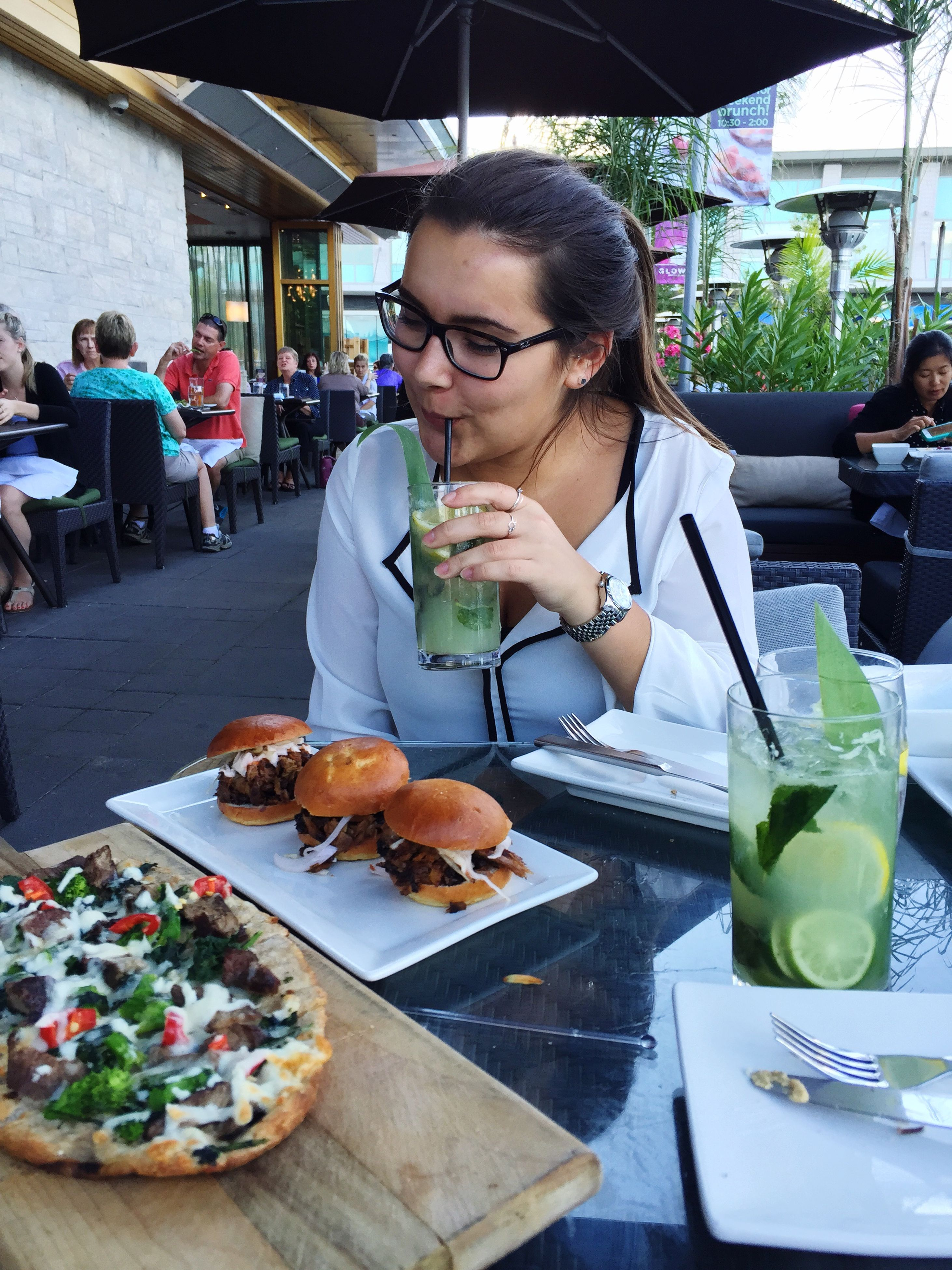 food and drink, food, freshness, lifestyles, holding, indoors, table, leisure activity, sitting, restaurant, healthy eating, casual clothing, ready-to-eat, incidental people, eating, indulgence, person