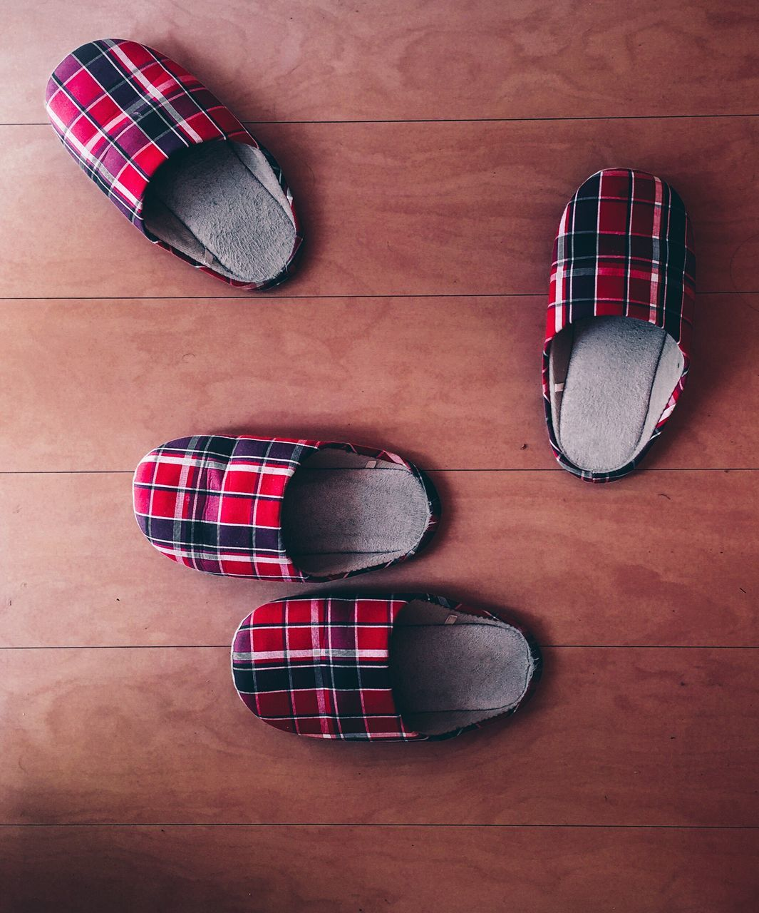 Directly Above Shot Of Slippers On Hardwood Floor