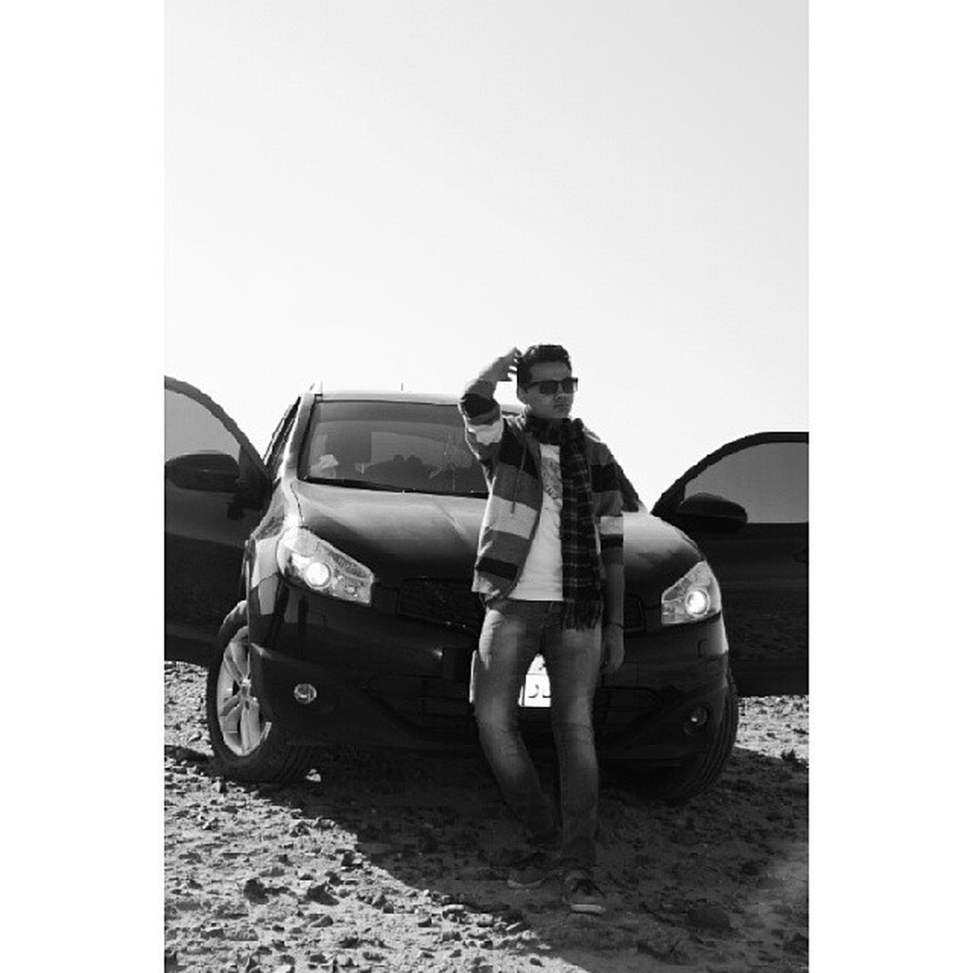 transportation, mode of transport, transfer print, lifestyles, full length, casual clothing, land vehicle, leisure activity, clear sky, auto post production filter, young adult, copy space, young men, sitting, men, car, person, standing
